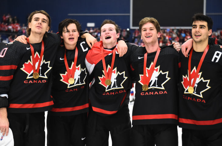 OSTRAVA, CZECH REPUBLIC - JANUARY 5: Canada's Raphael Lavoie #10, Barrett Hayton #27, Alexis Lafreniere #11, Dawson Mercer #20 and Joe Veleno #9 look on during the Canadian national anthem following a 4-3 gold medal game win against Russia at the 2020 IIHF World Junior Championship at Ostravar Arena on January 5, 2020 in Ostrava, Czech Republic. (Photo by Andrea Cardin/HHOF-IIHF Images)