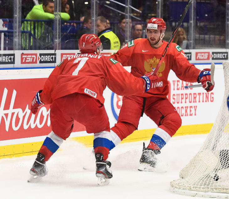 OSTRAVA, CZECH REPUBLIC - JANUARY 4: Russia's Yegor Sokolov #13 celebrates his first period goal against Sweden's with Alexander Khovanov #7 during semifinal round action at the 2020 IIHF World Junior Championship at Ostravar Arena on January 4, 2020 in Ostrava, Czech Republic. (Photo by Matt Zambonin/HHOF-IIHF Images)