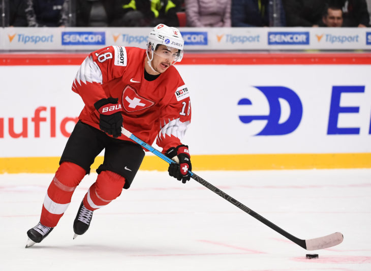 TRINEC, CZECH REPUBLIC - DECEMBER 28: Switzerland Valentin Nussbaumer #18 skates with the puck against Sweden during preliminary round action at the 2020 IIHF World Junior Championship at Werk Arena on December 28, 2019 in Trinec, Czech Republic. (Photo by Matt Zambonin/HHOF-IIHF Images)