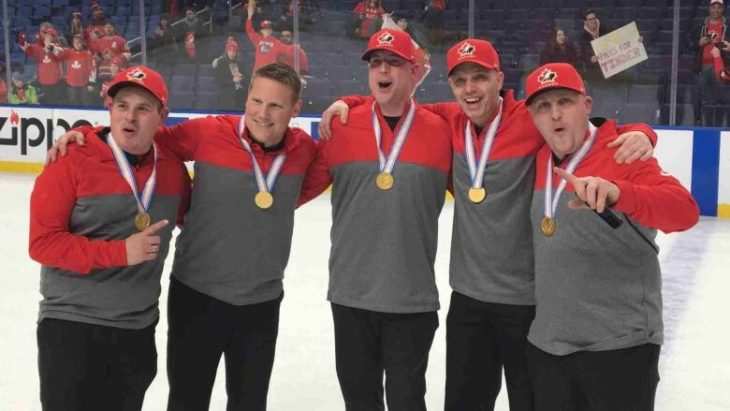 Brian St-Louis on the far left, with Kevin Elliot the second from the right, after winning gold in 2018.