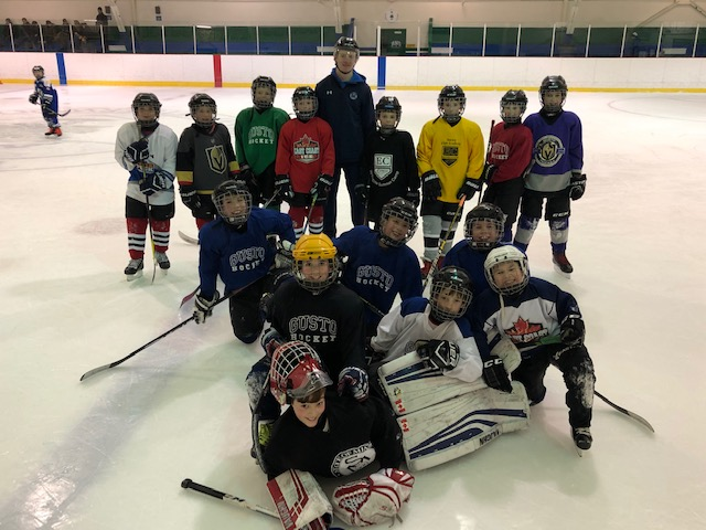 Sea Dogs Defenceman Kale McCallum helps out with a KV Atom A Sabres practice.